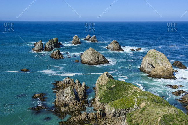 View from the Nugget Point Lighthouse in the turquoise waters with huge rocks- The Catlins- South Island- New Zealand