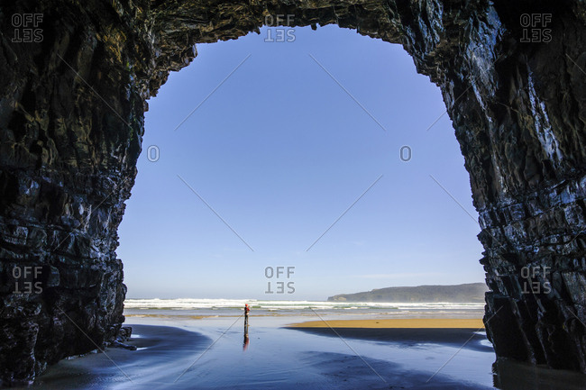 Woman standing in the giant Cathedral caves- The Catlins- South Island- New Zealand