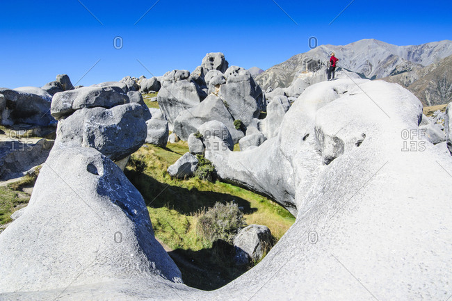 Woman standing on the Limestone outcrops of Castle Hill- South Island- New Zealand