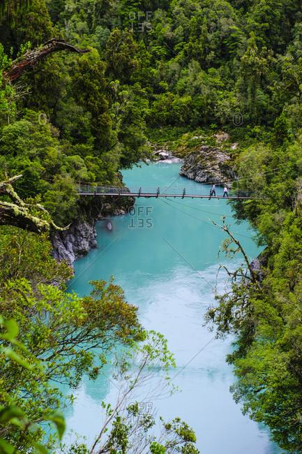 Swinging bridge above the turquoise water in the Hokitika Gorge- South Island- New Zealand