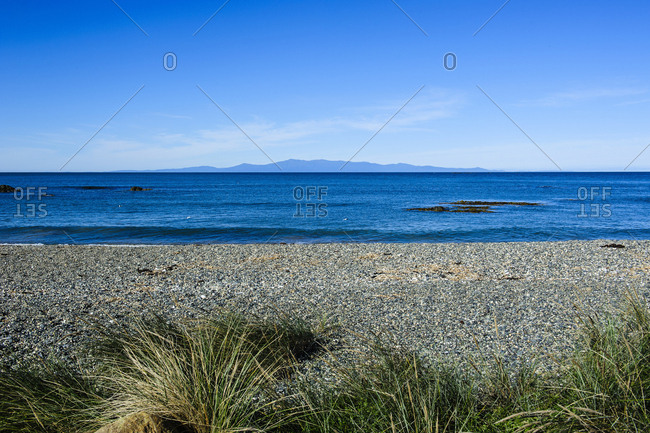 Taramea Bay in Riverton with a view on Stewart Island- South Island- New Zealand