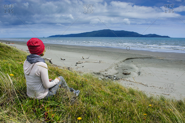 Woman resting at Foxton beach- Kapiti Coast- North island- New Zealand