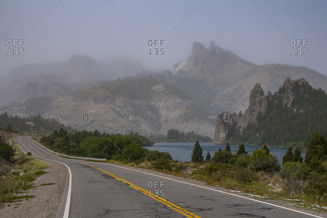 Fog above craggy hills- Road of the Seven Lakes- Argentina- South America