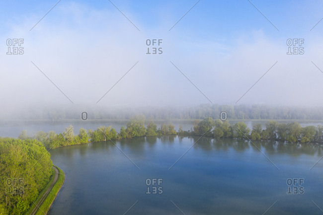 Morning fog at Altheim reservoir- Isar- near Landshut- Bavaria- Germany- drone shot