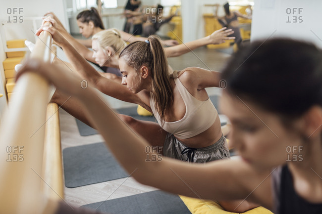 Young women doing barre workout in gym