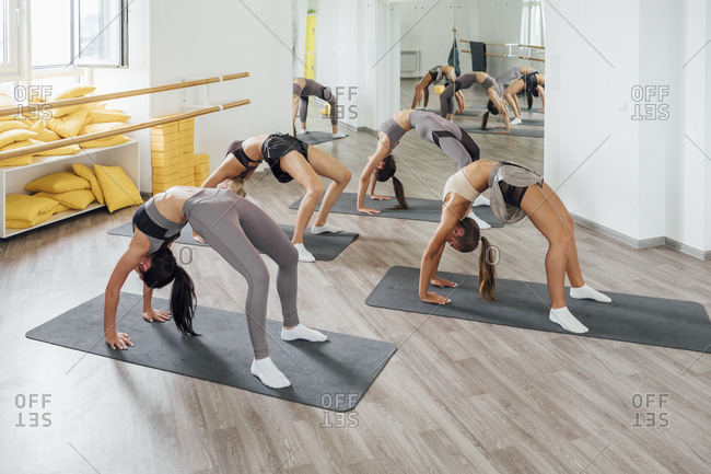 Young women doing gymnastics in gym