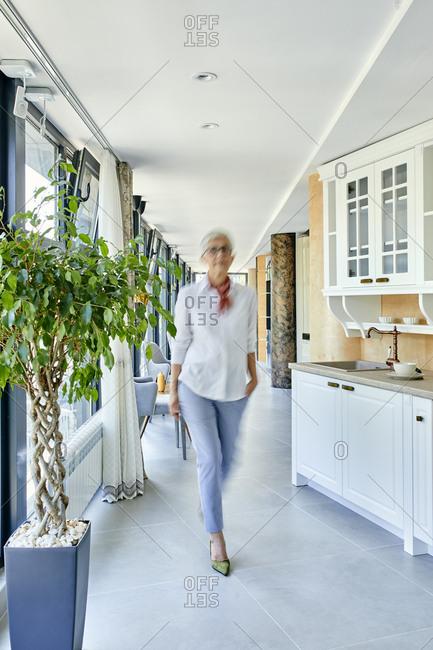 Senior woman walking through showroom of a furniture store