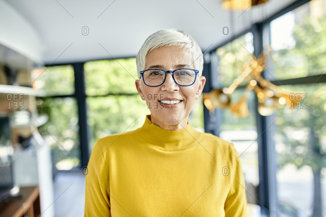 Portrait of a smiling senior woman at home