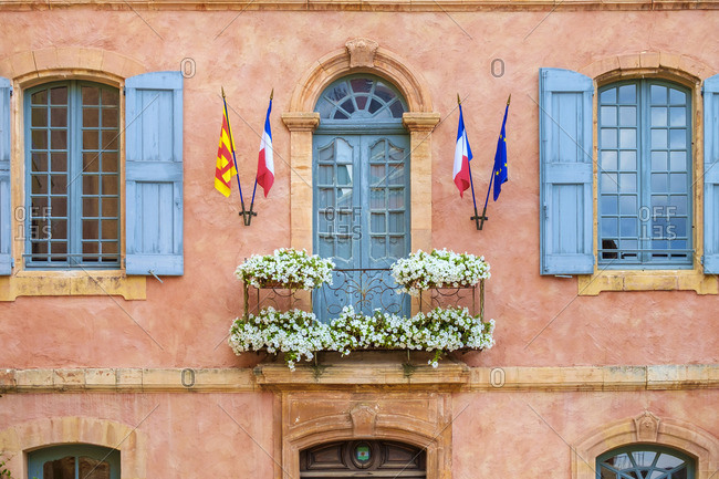 Colorful ochre colored facade of Mairie (mayor's office) in Roussillon, Vaucluse, Provence-Alpes-Cote d'Azur, France