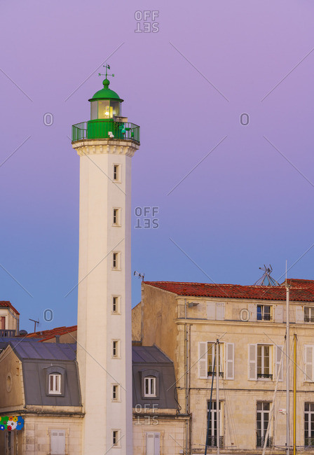 France - August 1, 2018: France, Poitou Charentes, La Rochelle, Old Harbor, lighthouse of Quai Duperre at dusk