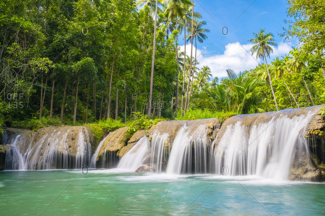 Cambugahay Falls surrounded by jungle foliage, Lazi, Siquijor Island, Central Visayas, Philippines