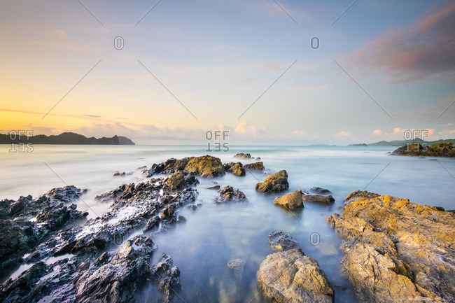 Long exposure of rocky coast along Bacuit Bay, El Nido, Palawan, Philippines