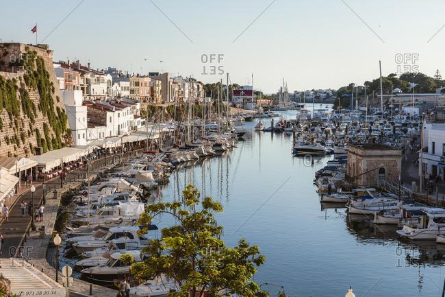 Spain - June 22, 2018: Historic harbor waterfront at sunset, Ciutadella, Menorca, Balearic Islands, Spain