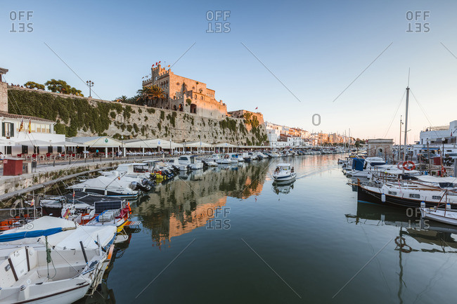Spain - June 22, 2018: Historic harbor waterfront and town hall at sunset, Ciutadella, Menorca, Balearic Islands, Spain