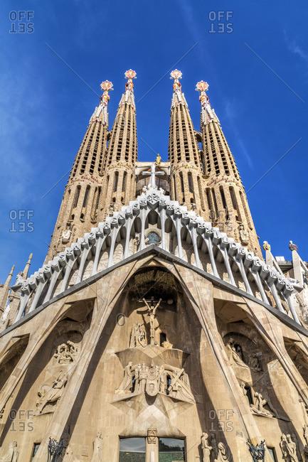 Spain - January 13, 2019: The Passion Facade of Sagrada Familia basilica church, Barcelona, Catalonia, Spain