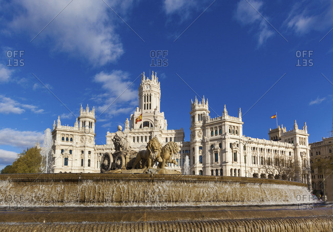 Spain, Madrid. Plaza de Cibeles with fountain and town hall building behind