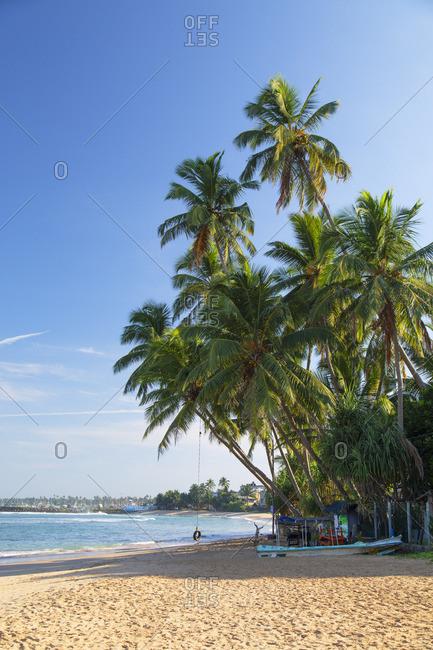 Sri Lanka - April 16, 2019: Hikkaduwa beach, Southern Province, Sri Lanka