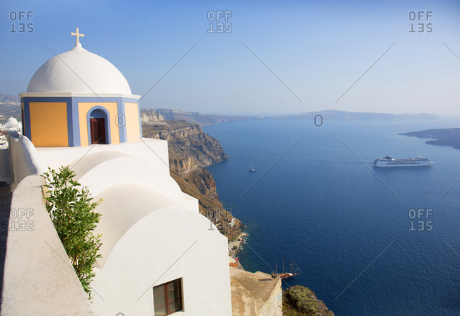 Church and cruise ship in the Aegean sea, Fira, Santorini, Greece