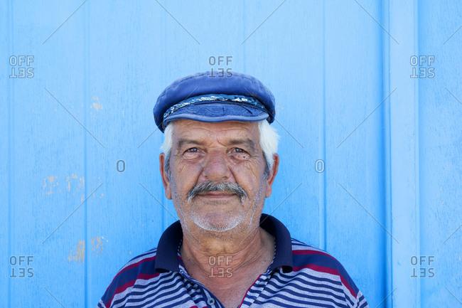 Fira, Santorini, Greece - May 26, 2019: Fisherman in the Fira Village