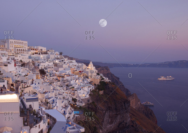 Fira, Santorini, Greece - May 26, 2019: Aegean sea at magic hour