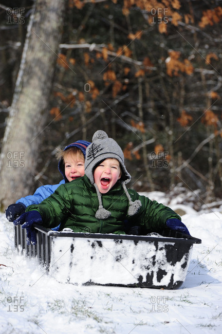 Two Boys Playing In The Snow