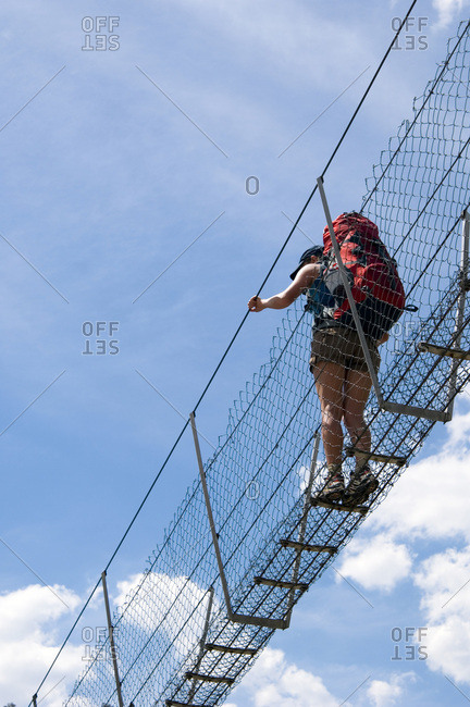 Hiker crossing the Bowtell Swing Bridge.