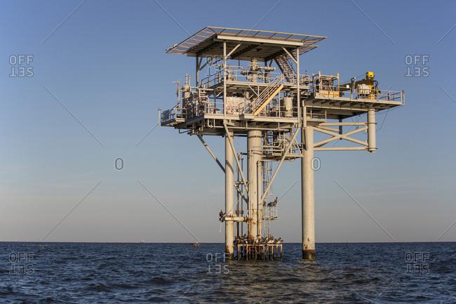 Oil platform against clear sky at dawn, Lake Charles, Louisiana, USA
