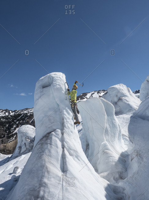 A man ice climbing on the coleman glacier on Mount Baker, Washington.