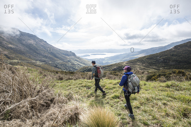 Two backpackers hiking along Mount Herbert Trail, Christchurch, Canterbury, New Zealand