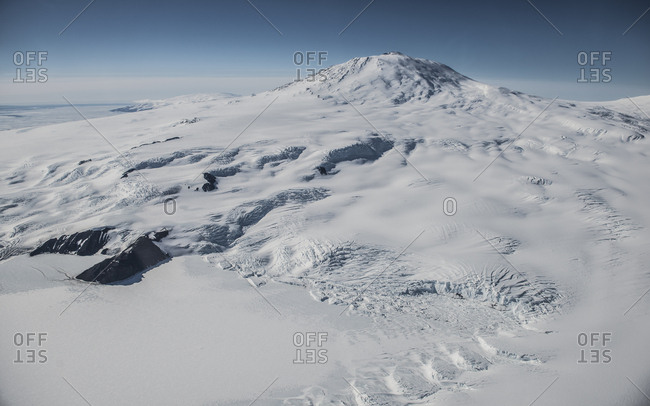 Aerial image of Mount Erebus Antarctica with Erebus bay in the foreground.