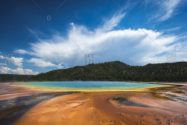 Cloud mirrors shape of Grand Prismatic Spring in Yellowstone National Park, Wyoming, USA