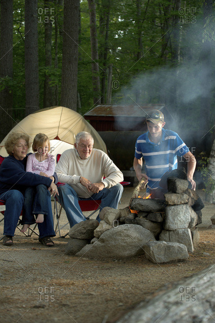 Maine Camp Life: A family cooks over an open fire at a camp site on Crystal Lake near Harrison, Maine.