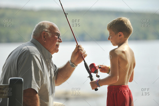 Maine Camp Life: A man talks fishing with a young boy on Crystal Lake near Harrison, Maine