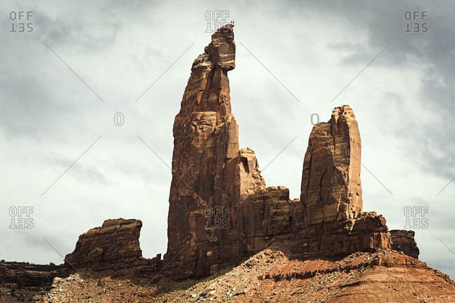 Climbers standing on top of Moses rock tower, Moab, Utah, USA