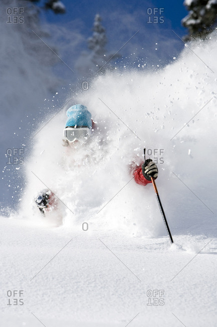 A man skiing some deep powder at Snowbird Utah.