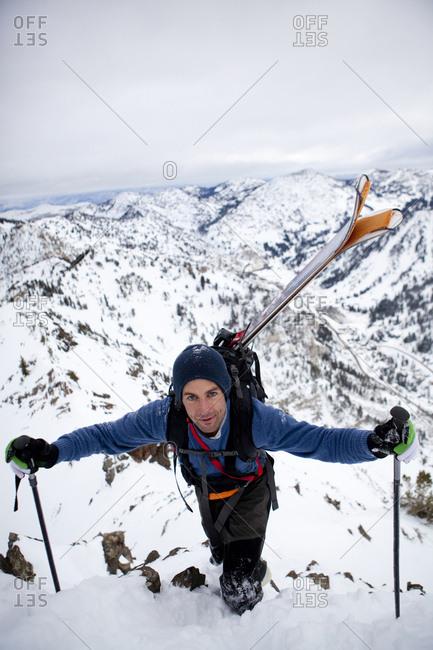 A man hiking the ridge if Mt Superior, Utah