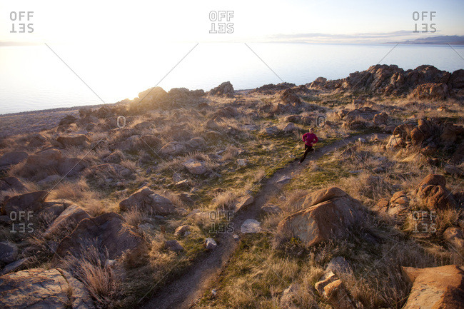 A woman out for an afternoon trail run on Antelope Island, Utah.