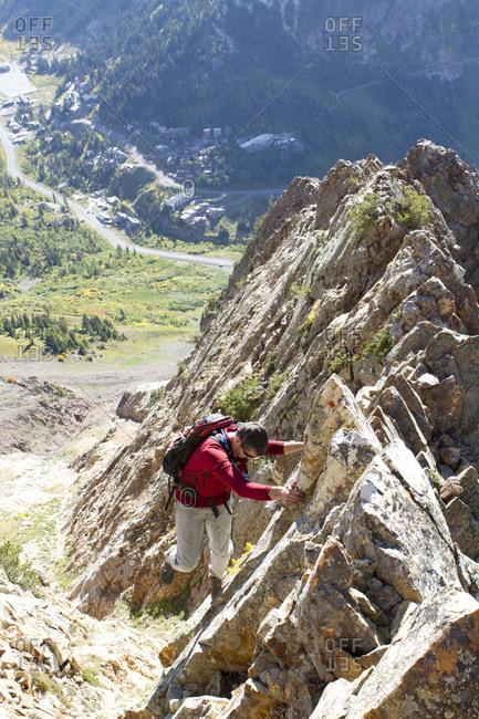 A man enjoying a fall hike on the South Ridge of Mt Superior, Utah