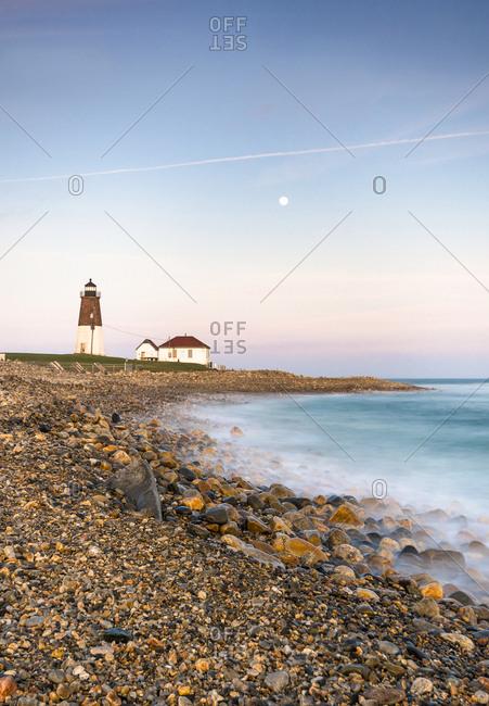 A Dusky Winter Moonrise Over Point Judith Lighthouse Of Narragnsett, Rhode Island