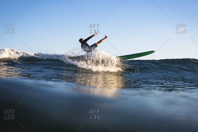 Surfer falling down, Narragansett, Rhode Island, USA