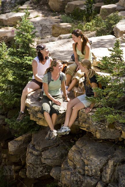 Four women take a break to talk during a hike in Utah's Uinta Mountains.