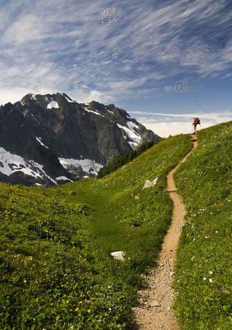 A backpacker hoofs it up the Sahale Arm Trail high above Cascade Pass in the North Cascades National Park, Washington State.