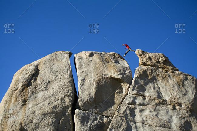 Climber jumping across a gap.