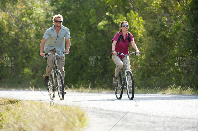 A couple ride bicycles in Everglades National Park, Florida.