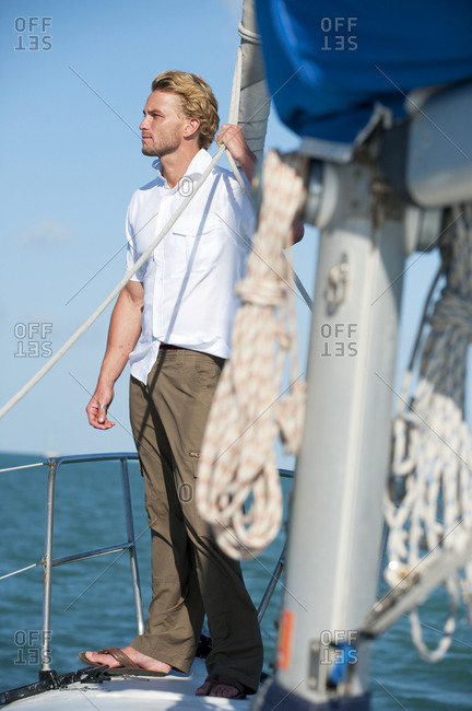 A man stands on a boat off of Florida.