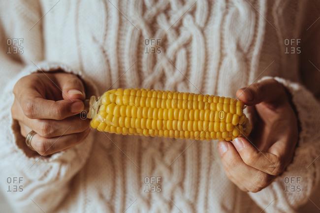 Woman holding corn on the cob