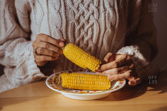 Woman eating fresh corn on the cob