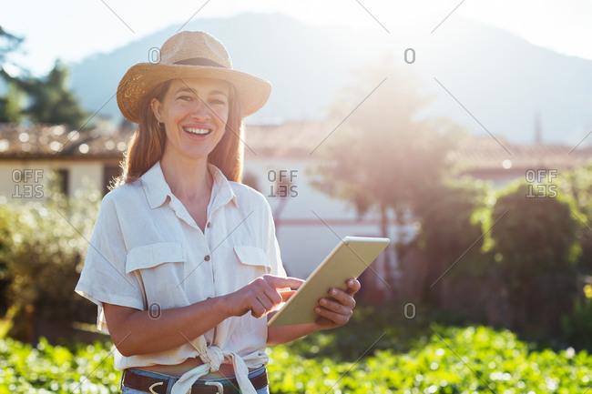 Woman using a tablet in a vegetal garden