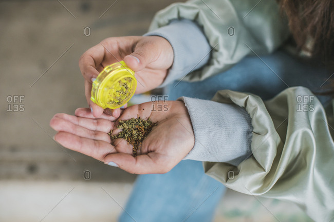 Woman preparing marijuana joint- close-up