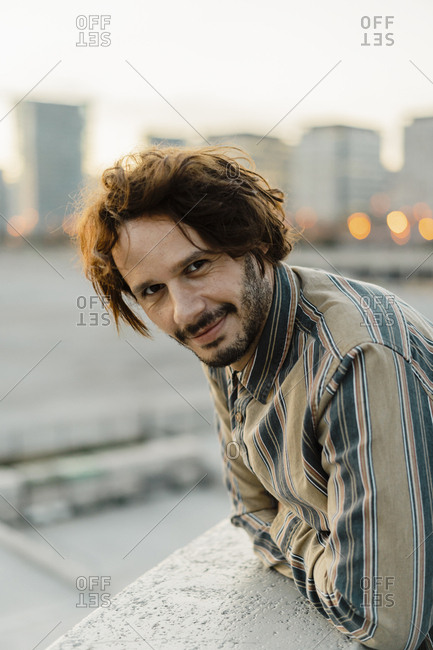 Portrait of relaxed man relaxing during sunset- Barcelona- Spain